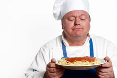 Happy attractive cook with spaghetti Royalty Free Stock Photo
