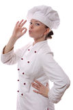 Happy attractive cook woman. Becoming lean the fingers a over white background Royalty Free Stock Image