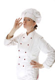 Happy attractive cook woman. Becoming lean the fingers a over white background Royalty Free Stock Photos