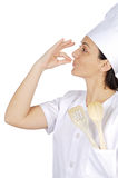 Happy attractive cook woman becoming lean the fingers Royalty Free Stock Image