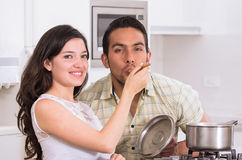 Happy attractive couple cooking together Stock Photos