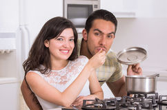 Happy attractive couple cooking together Royalty Free Stock Photo