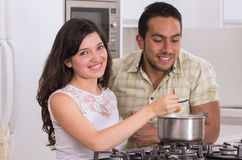Happy attractive couple cooking together Stock Photo