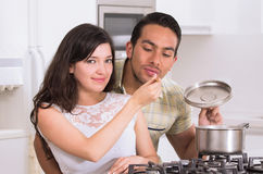 Happy attractive couple cooking together Royalty Free Stock Photography