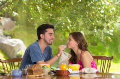 Happy, attractive couple eats breakfast together Stock Photo
