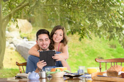 Happy, attractive couple eats breakfast together Royalty Free Stock Images