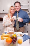 Happy Attractive Couple In Kitchen Stock Photos