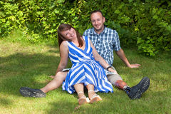 Happy attractive couple relaxing in the garden Stock Photo