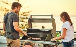 Free Happy Attractive Couple Standing Together On A Rooftop Barbecue Stock Photos - 92154713