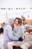 A happy attractive couple wearing winter coats is spending time together outdoors stock images