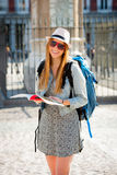 Happy attractive exchange student girl having fun in town visiting Madrid city reading tourist guide book Royalty Free Stock Images