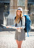 Happy attractive exchange student girl visiting Madrid city reading map Royalty Free Stock Photo