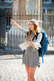 Happy attractive exchange student girl visiting Madrid city reading map Stock Image