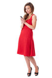 Happy attractive female in red dress text someone Royalty Free Stock Photography