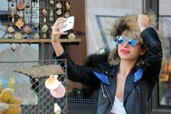 Happy attractive girl self portrait. Happy attractive afro curly beautiful girl self portrait sunglasses spring stock photo