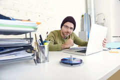 Happy attractive hipster businessman working with computer laptop at home office. Corporate young attractive hipster businessman working with computer laptop at Stock Images