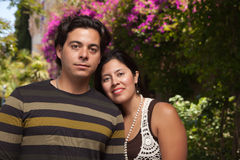 Happy Attractive Hispanic Couple At The Park Royalty Free Stock Photography