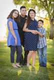 Happy Attractive Hispanic Family With Their Pregnant Mother Outd Stock Images