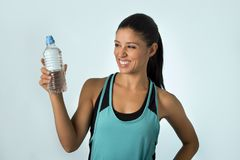 Happy and attractive latin sport woman in fitness clothes holdi royalty free stock photo
