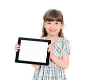 Happy little girl holding a blank apple ipad. Happy attractive little girl holding a blank tablet up in her hands so that the blank screen with white copyspace Royalty Free Stock Image