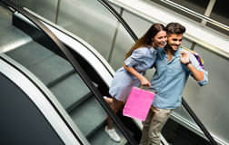 Happy attractive loving couple enjoy shopping together Stock Photography