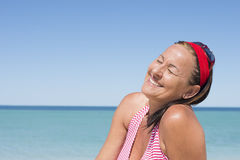 Happy attractive mature woman beach holiday Royalty Free Stock Images