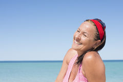 Happy attractive mature woman ocean holiday Royalty Free Stock Images