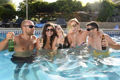 Happy attractive men and women in bikini having bath at hotel resort swimming pool drinking beer Stock Images