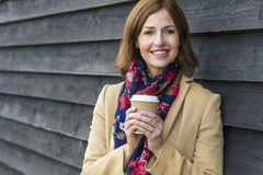 Happy Attractive Middle Aged Woman Drinking Coffee Royalty Free Stock Photography