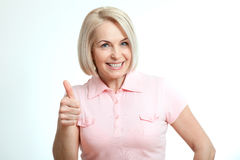 Happy attractive middle aged woman showing thumbs up, okay.  Stock Photography