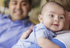 Happy Attractive Mixed Race Couple Burping Thier Son Royalty Free Stock Photo