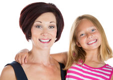 Happy attractive mother and daughter smiling Stock Photography
