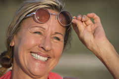 Happy attractive senior woman with sunglasses Stock Images