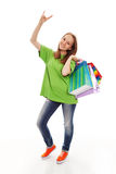 The happy customer. The happy attractive teenager girl standing with bags for purchases on a white background stock photo