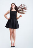 Happy attractive woman with beautiful long dark hair in motion Stock Photography