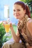Happy attractive woman enjoys cold drink. Royalty Free Stock Images