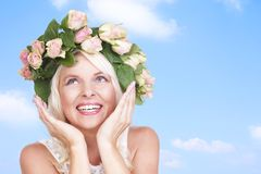 Happy attractive woman with flowers in her hair Royalty Free Stock Photo