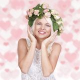 Happy attractive woman with flowers in her hair Stock Images