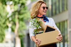 happy attractive woman holding paper box with office stuff stock images