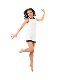 Happy attractive woman jumping in studio. Isolated on white Stock Photo