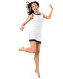 Happy attractive woman jumping in studio. Isolated on white Royalty Free Stock Photos