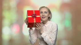 Happy attractive woman with present box. stock video footage