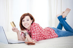 Happy attractive woman with red hair online shopping Stock Photography