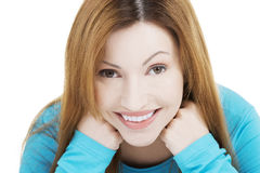 Happy attractive woman sitting Stock Photography