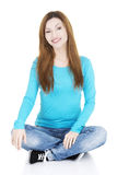Happy attractive woman sitting Stock Image