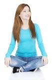 Happy attractive woman sitting Stock Photos