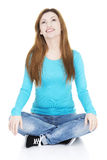 Happy attractive woman sitting Royalty Free Stock Photo