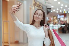Beautiful young woman shopping at the local mall royalty free stock photo