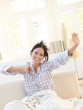 Happy attractive woman stretching in pyjama Royalty Free Stock Images
