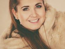 Happy attractive woman wearing furry coat Stock Image